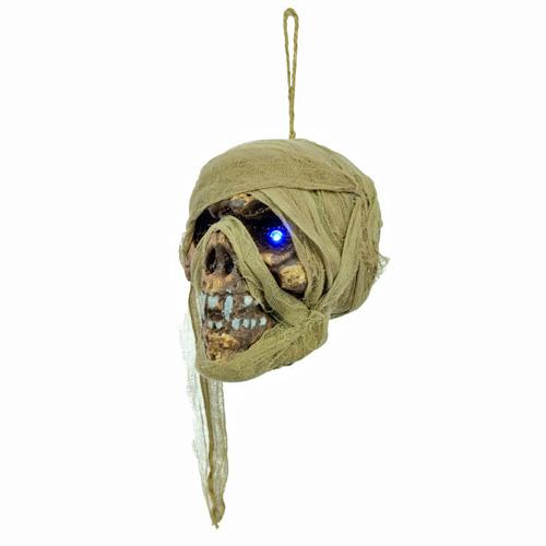 EUROPALMS Halloween muumiopääkallo 15cm sinisillä LED-silmillä. Todella aktiivinen muumiopääkallo, rätti pään ympärillä. operointi 3x 15V pattereilla. On - Off kytkin. Korkeus 15cm.